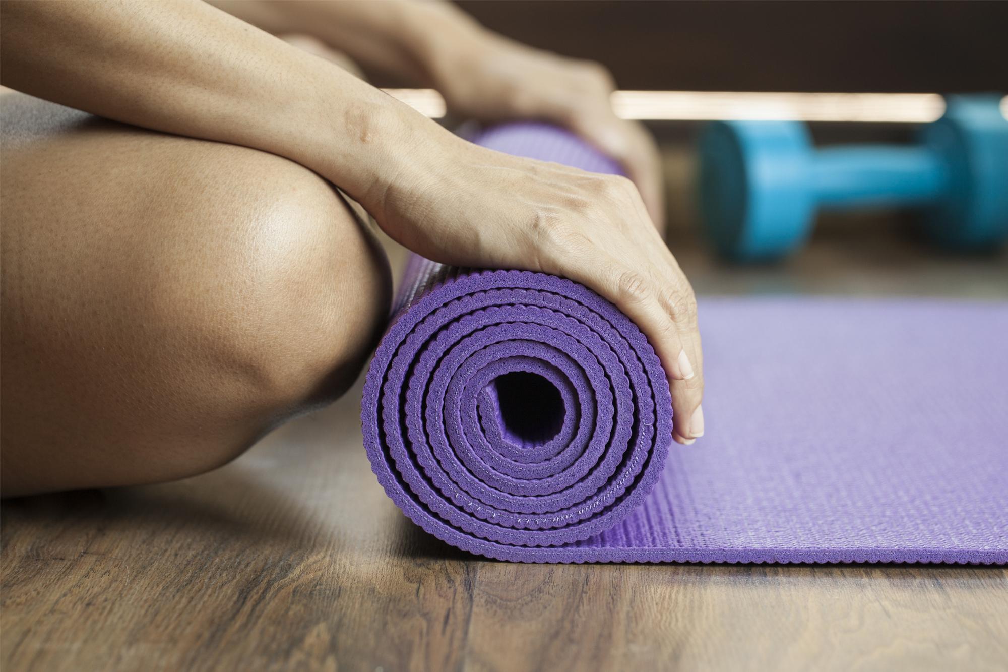 rolling a yoga mat